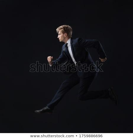 Empresario rápidamente determinado traje negocios hombre Foto stock © alphaspirit