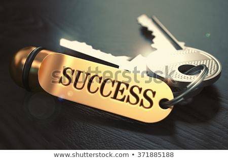 positiviteit · sleutels · gouden · zwarte · houten · tafel - stockfoto © tashatuvango