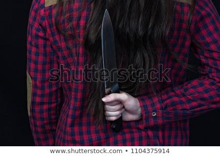 Menina faca mão atrás de volta Foto stock © sharpner