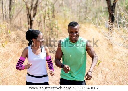 Paar beim Joggen im Wald Stock photo © Kzenon