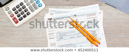 Laptop and calculator on 2015 IRS form 1040 Stock photo © backyardproductions