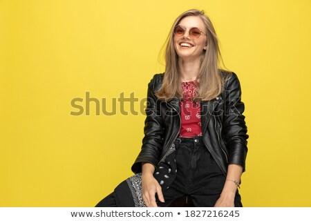 jonge · blonde · vrouw · lachend · zwarte - stockfoto © feedough