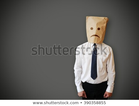 businessman with an unhappy face on a paper bag stock photo © andreasberheide