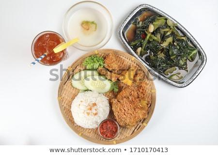 Deep fried chicken meat and ice green tea Stock photo © nalinratphi