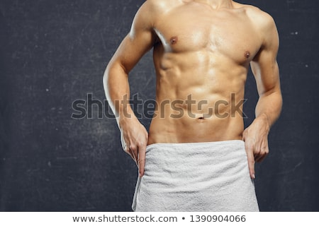 torso of attractive male body builder on gray background. Stock photo © master1305