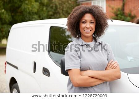 Young woman standing by van Stock photo © wavebreak_media
