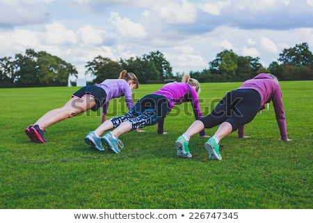 Group of women jogging together in the boot camp Stock photo © wavebreak_media