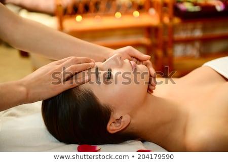 Woman enjoying Ayurveda oil head massage in spa Stock photo © julenochek