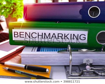 green office folder with inscription benchmarking stock photo © tashatuvango
