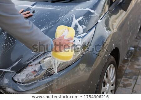 Auto usługi pracowników mycia samochodu gąbki Zdjęcia stock © wavebreak_media