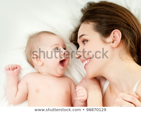 mother baby on bed stock photo © is2