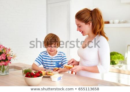 Kid Boy Preparing Healthy Snack Stock photo © lenm