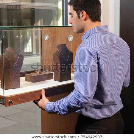 man opening/closing jewelry display Stock photo © IS2