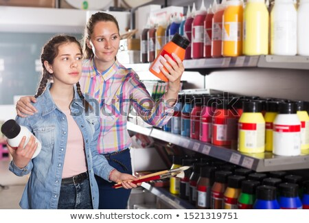 mother and daughter choose paint colors stock photo © is2