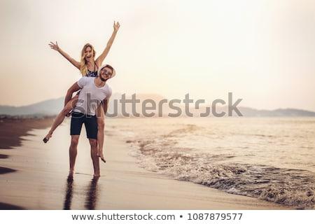 Stock photo: 2 girls having fun at the beach