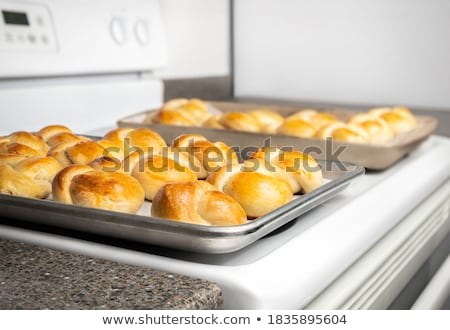 knot shaped dinner rolls stock photo © digifoodstock