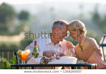 Mature couple enjoying a meal Stock photo © IS2