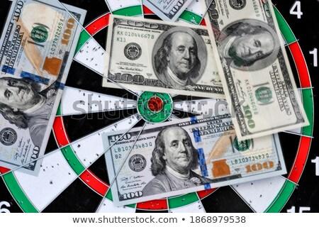 Darted hundred dollars on dart board Stock photo © wavebreak_media