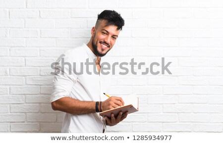 learn arabic on the white brick wall stock photo © tashatuvango