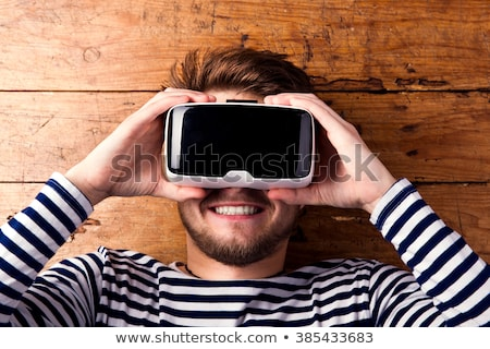 man face with glasses virtual reality Stock photo © studiostoks