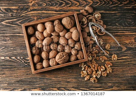 Walnuts and nutcracker on table Stock photo © dash