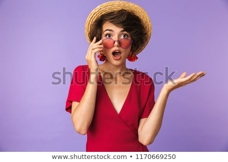 Surprised elegant woman in straw hat take off sunglasses Stock photo © deandrobot