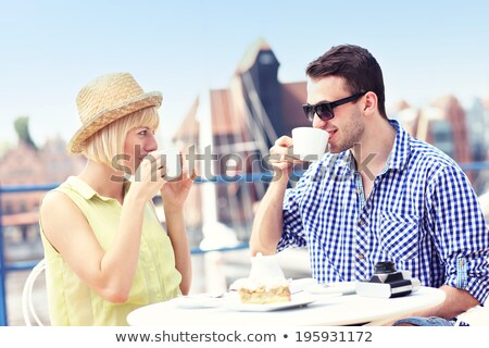 happy tourist woman with camera at city cafe Stock photo © dolgachov