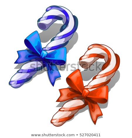 cartoon candy cane with decorative red and blue ribbon bow isolated on white background classic chr stock photo © lady-luck