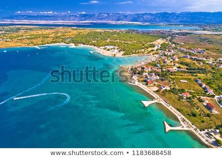 Aerial view of Zaton tourist waterfront and Velebit mountain bac stock photo © xbrchx