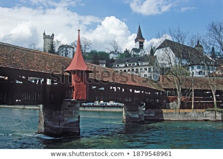 Luzern and Reuss river waterfront and famous landmarks view stock photo © xbrchx