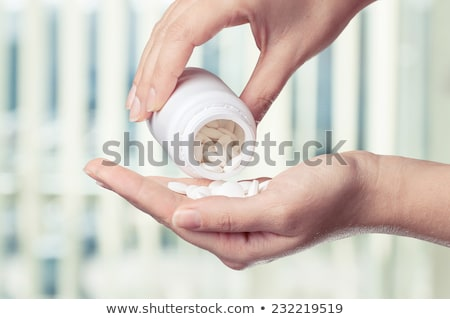 Stock photo: doctor taking hand full of tablets