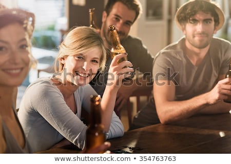 Portrait Of Men With Bottled Beer At Pub Stock photo © AndreyPopov