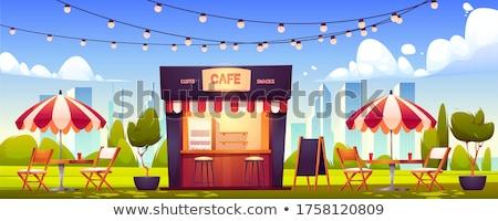 a street cafe with an umbrella and lights stock photo © galitskaya