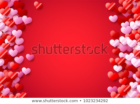 Valentines Day card with scattered colorful foil hearts Stock photo © SwillSkill