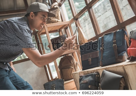 Online seller owner take a photo of product for upload to websit Stock photo © ijeab