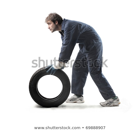 Young boy with a car tires isolated on white Stock photo © Lopolo