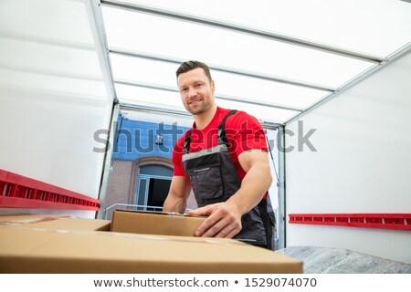 Jeunes Homme cases à l'intérieur van portrait Photo stock © AndreyPopov