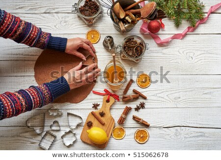 Fresh baked Christmas shaped gingerbread cookies placed on steel grill Stock photo © dash
