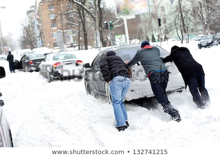 Man Pushing A Car Stuck In The Snow Stock photo © AndreyPopov