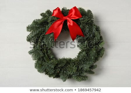 Handcraft round wreath from twigs on a white background. Stock photo © artjazz
