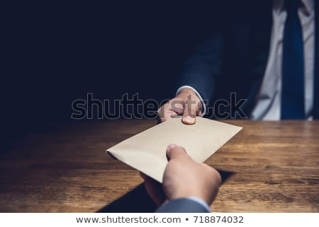 businessman receive an envelope for bribing, money corruption of Stock photo © snowing