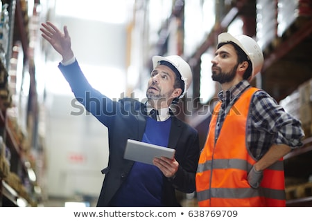 Warehouse manager talk with worker about logistic Stock photo © vichie81