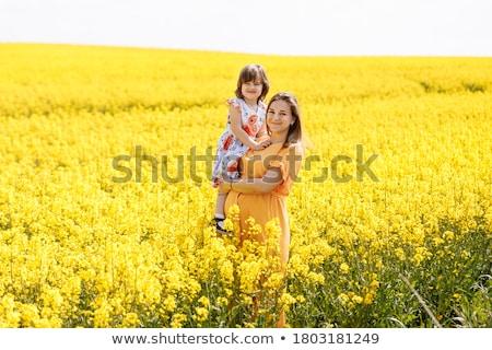grávida · menina · flores · feliz · mão - foto stock © paha_l