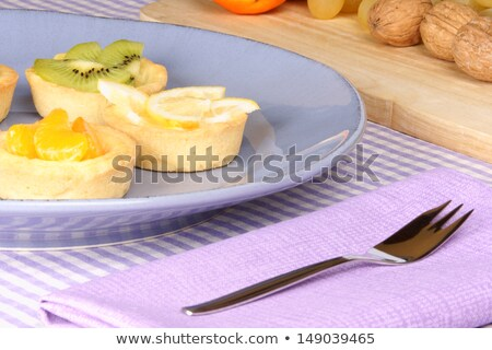 mini tangerine and lemon fruit tarts stock photo © aladin66