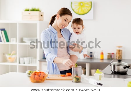 Woman holding food blender Stock photo © photography33