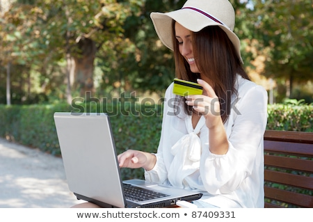 Young elegant woman wearing straw hat and white dress holding cr Stock photo © HASLOO