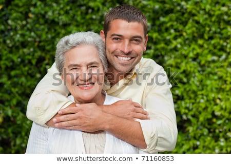 Yetişkin oğul yaşlanma anne aile eller Stok fotoğraf © photography33