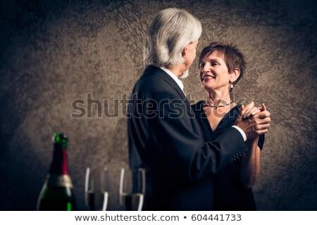 Casal velho garrafa champanhe mãos festa cara Foto stock © photography33