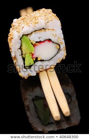 Californian roll on chopsticks Stock photo © photography33