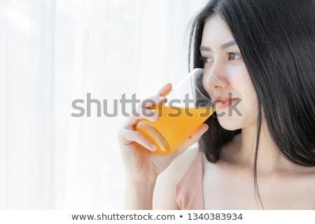 vrouw · sinaasappelsap · glimlach · gelukkig · home - stockfoto © photography33